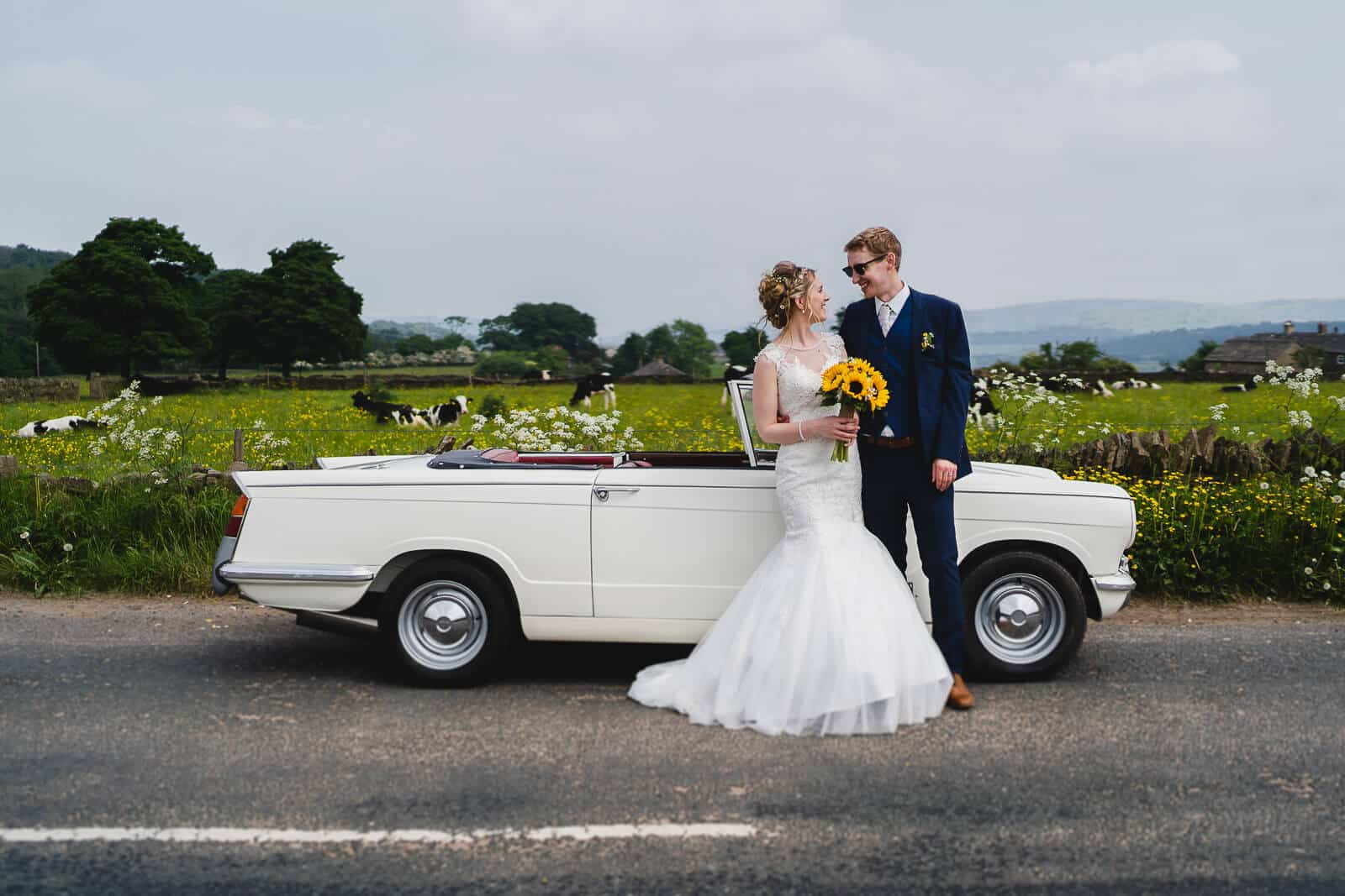 Bride and Groom In countryside with car